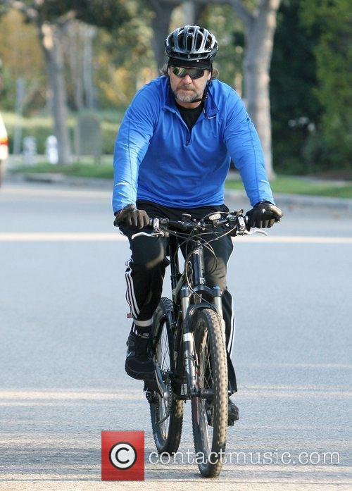 Russell Crowe dressed in adidas sportswear goes cycling...