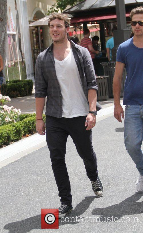 Sam Claflin was spotted shopping at The Grove...