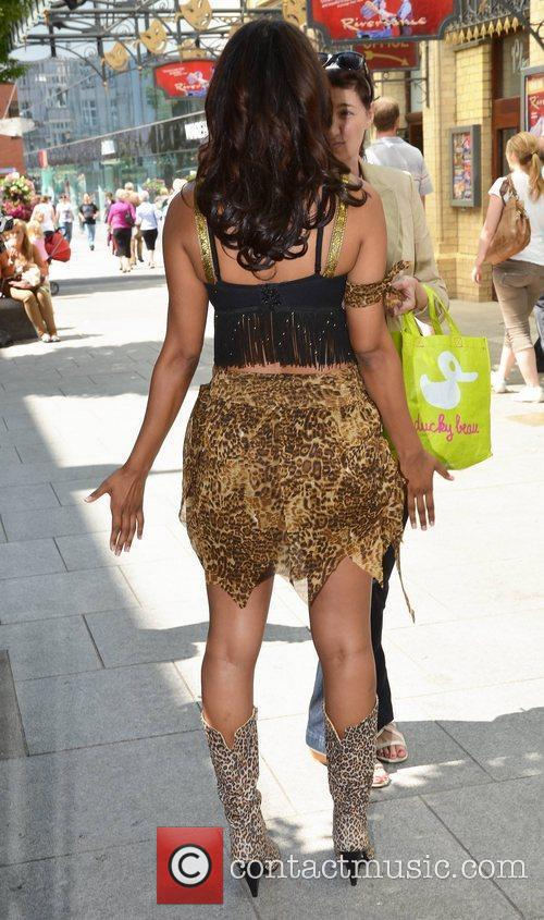 Samantha Mumba poses in costume as 'Girl Friday'...