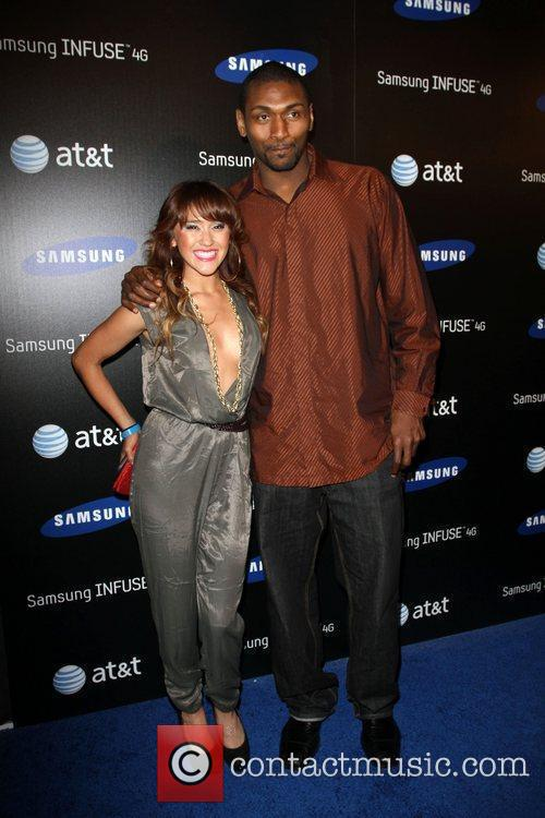 Ron Artest (R) and guest Samsung Infuse 4G...