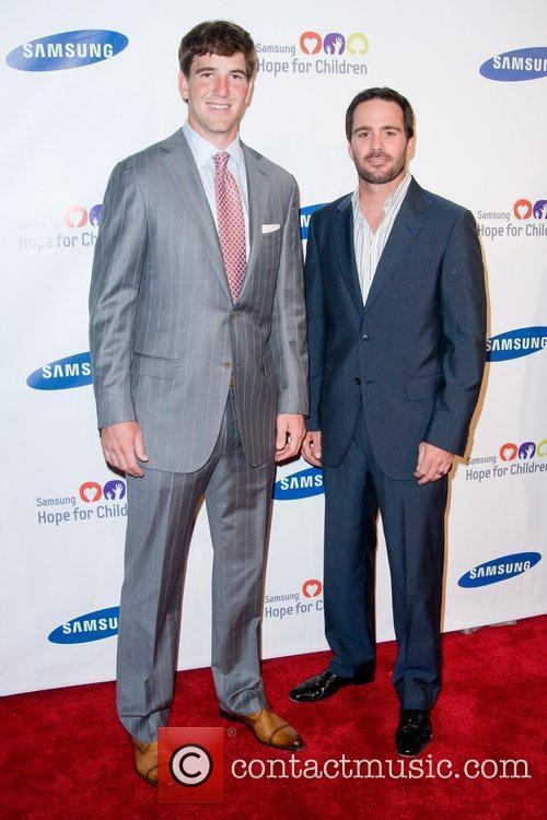 Eli Manning and Jimmie Johnson 2011 Samsung Hope...