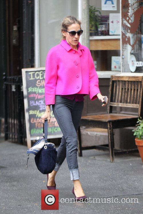 Out walking in Soho wearing a bright pink...