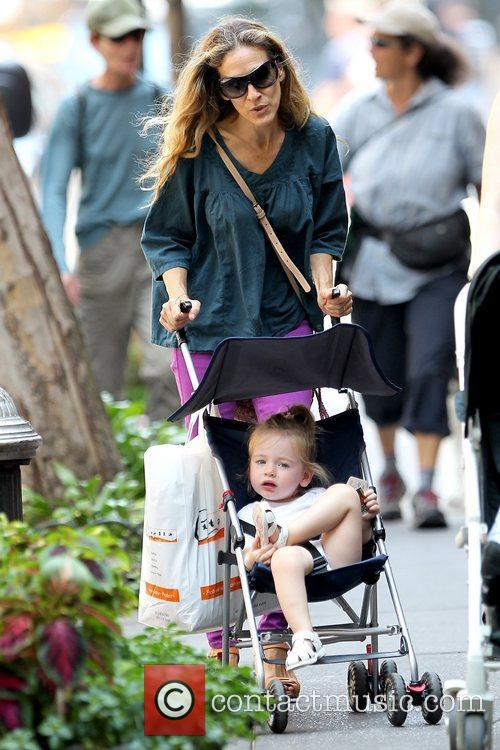 Sarah Jessica Parker pushing one of her twin...