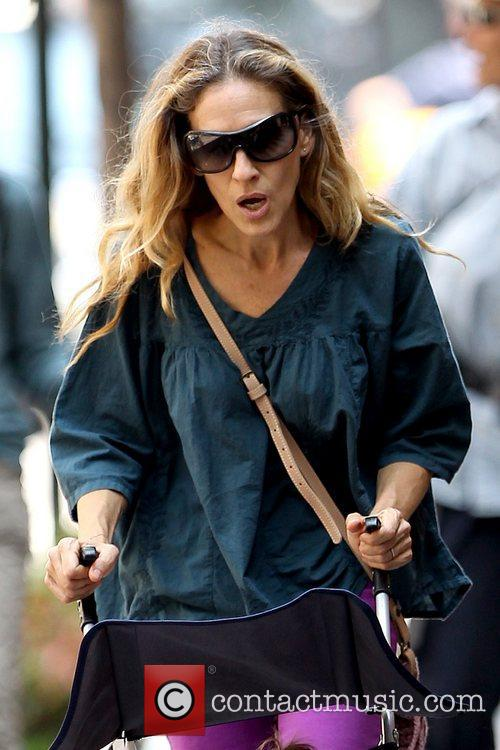 Sarah Jessica Parker  pushing one of her...