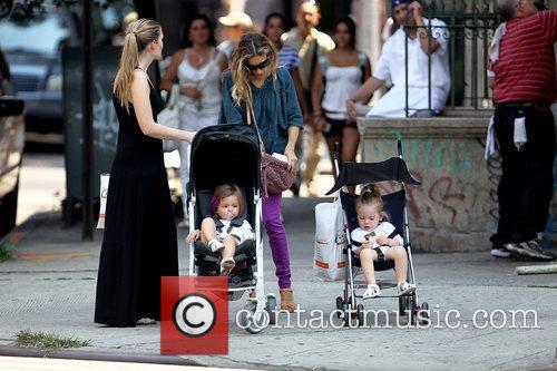 Sarah Jessica Parker and a nanny pushing her...