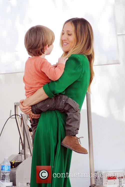 Sarah Jessica Parker holds a child on the...