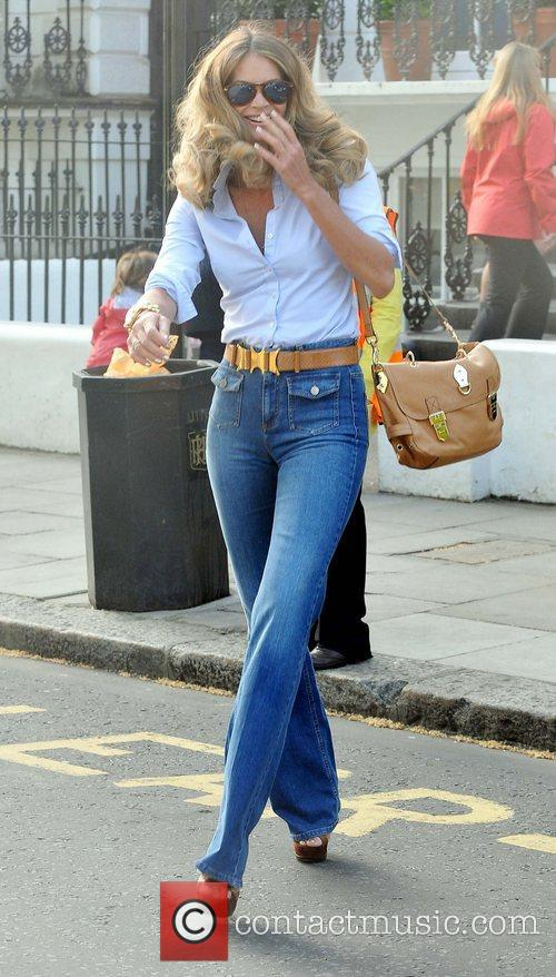 Elle Macpherson after dropping her son Aurelius off...