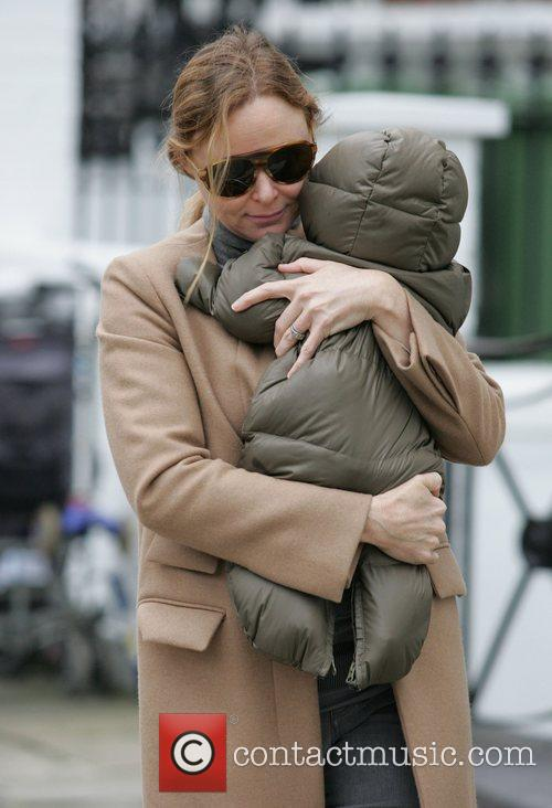 Carrying her baby daughter Reiley after dropping her...