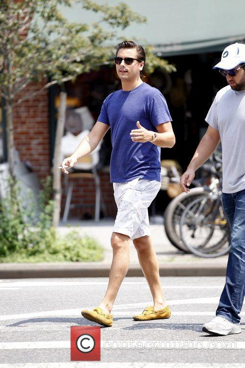 Scott Disick walking with a friend in Soho...