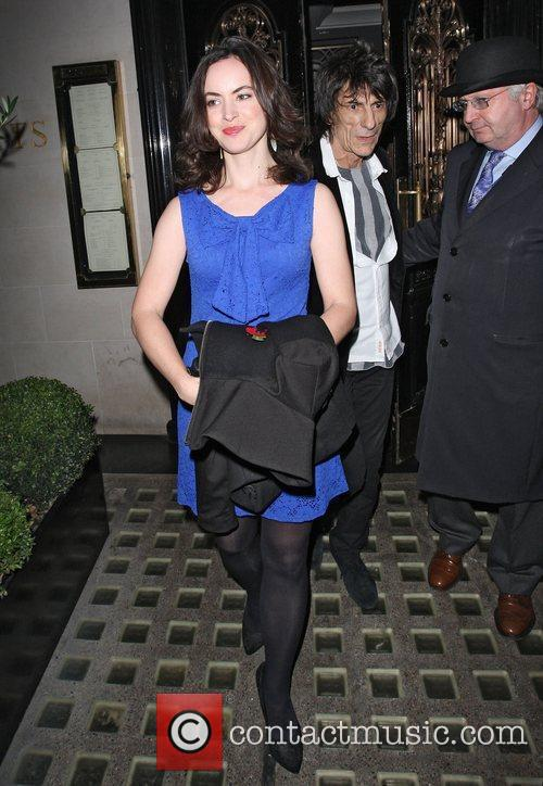Ronnie Wood and female companion leaving Scotts restaurant.