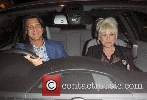 Barbara Windsor and her husband Scott Mitchell leaving...