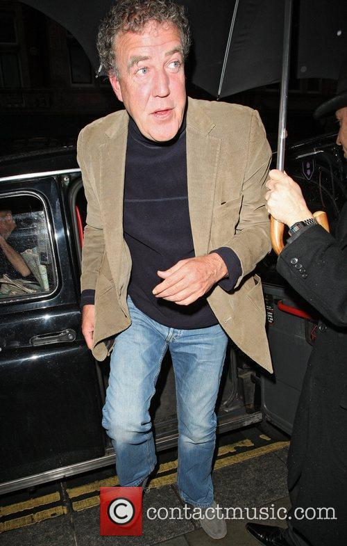 Arriving at Scott's Restaurant in Mayfair with his...
