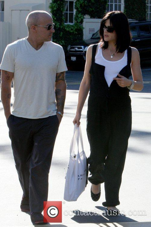 Runs errands with a friend in West Hollywood