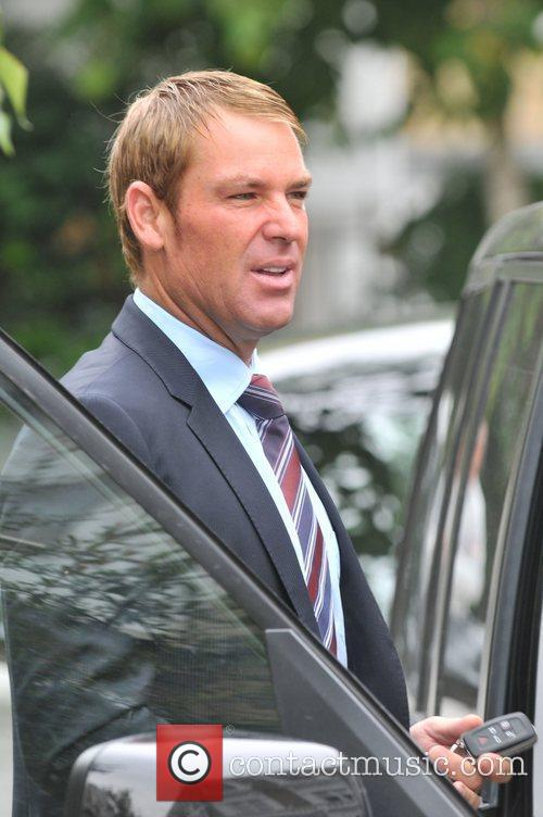 Shane Warne leaving his girlfriend Liz Hurley's house...