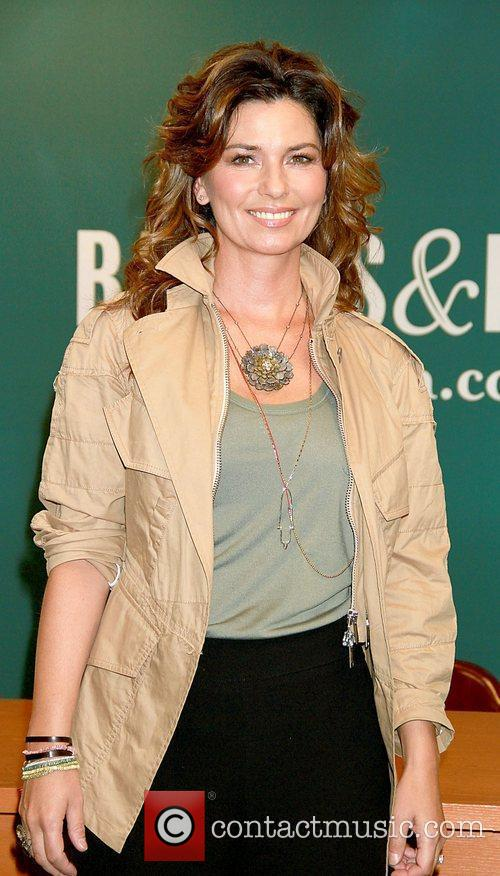 Shania Twain  signs her new book 'From...