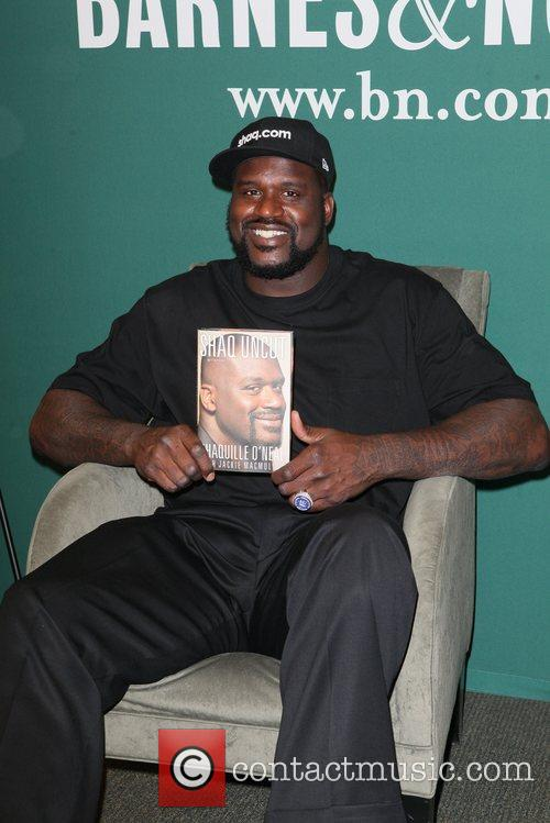 Promotes his new book, 'Shaq Uncut: My Story,'...