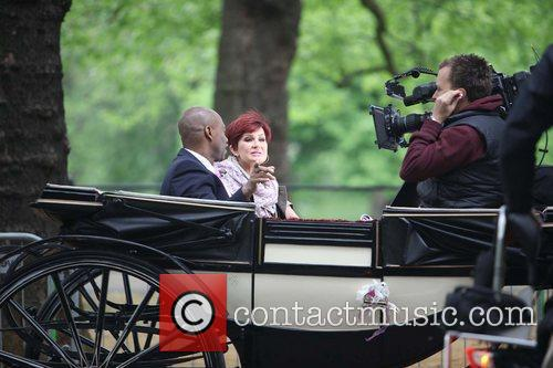 Sharon Osbourne is interviewed while sitting on a...