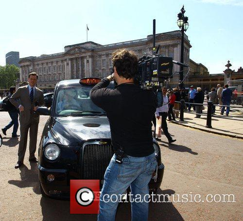 Filming outside Buckingham Palace during preparations for the...