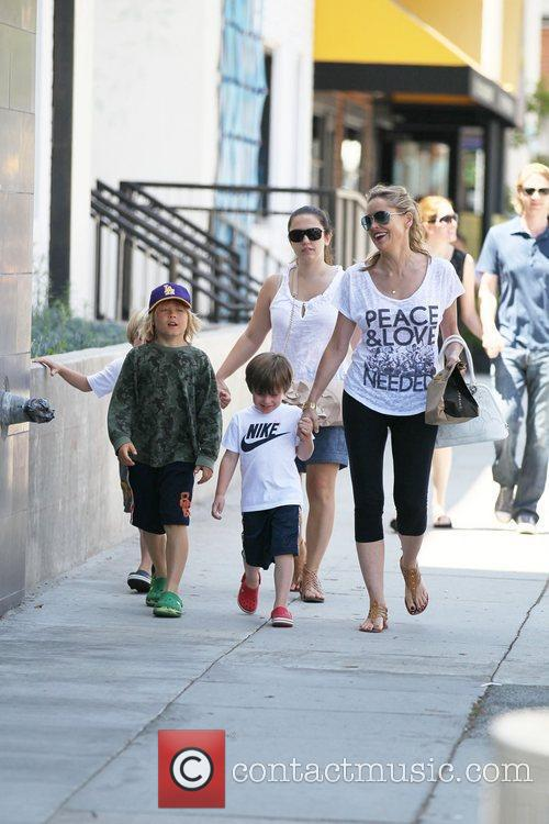 Sharon Stone takes her three adopted sons, Roan...