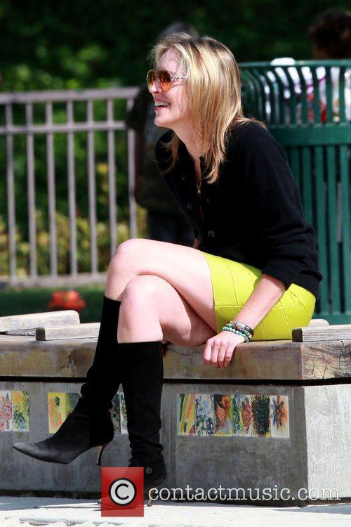 Sharon Stone wearing a fluoro green mini skirt...