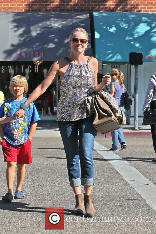 Roan Bronstein and Sharon Stone Sharon Stone takes...