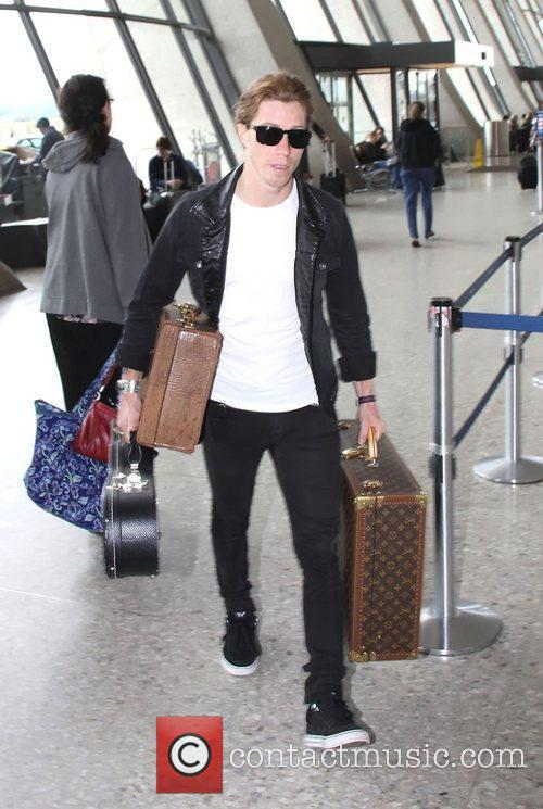 With his cases at the airport to take...