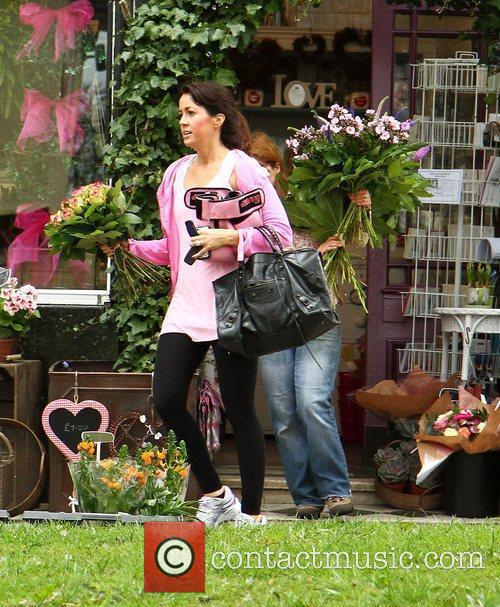 Sheree Murphy leaves a florist with a bunch...