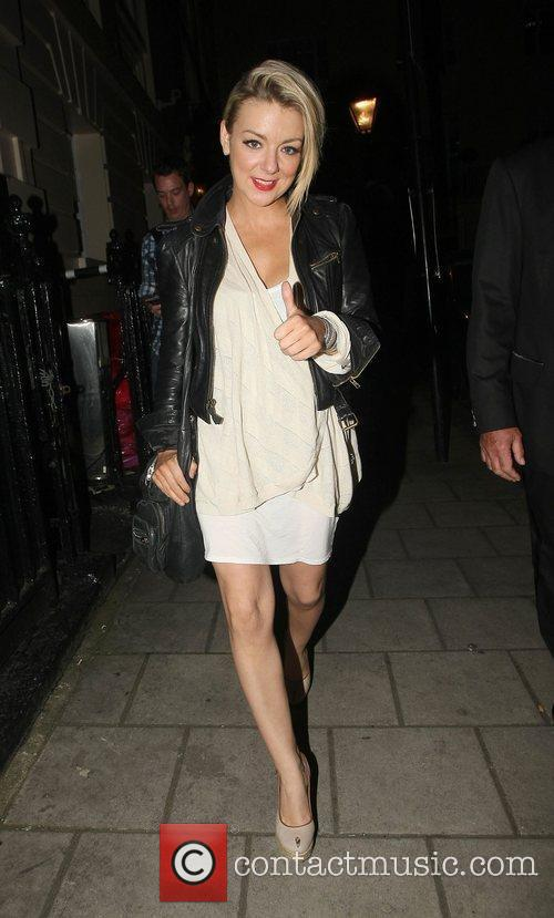 Leaving the Theatre Royal Haymarket after performing in...