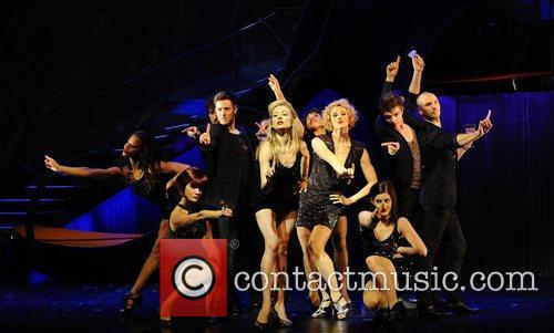 Cast of 'Shoes' perform on stage at the...