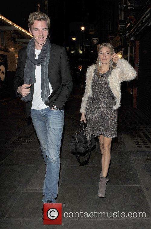 Sienna Miller and a male companion arrive for...