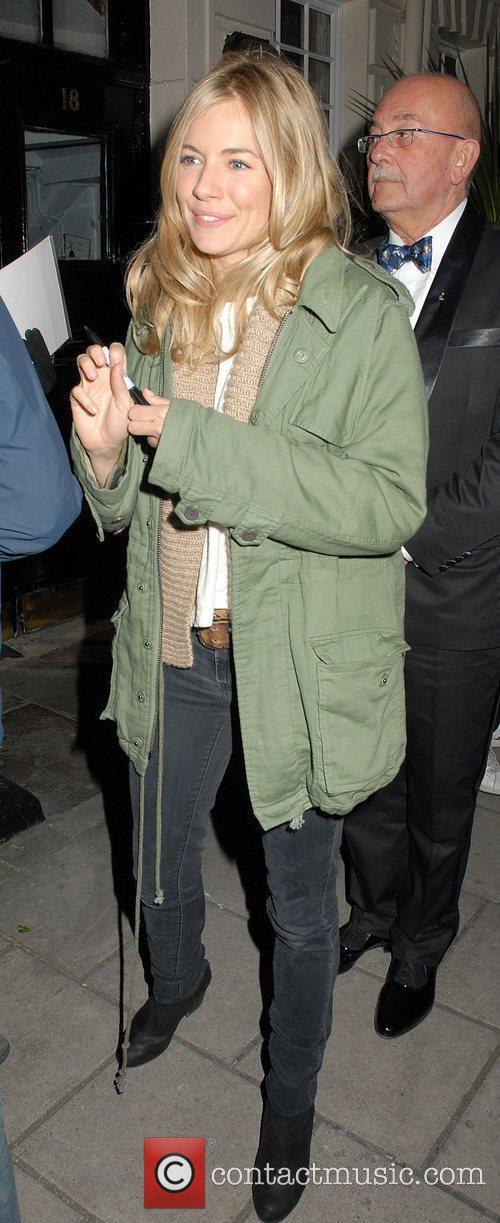 Sienna Miller leaving the Theatre Royal Haymarket where...