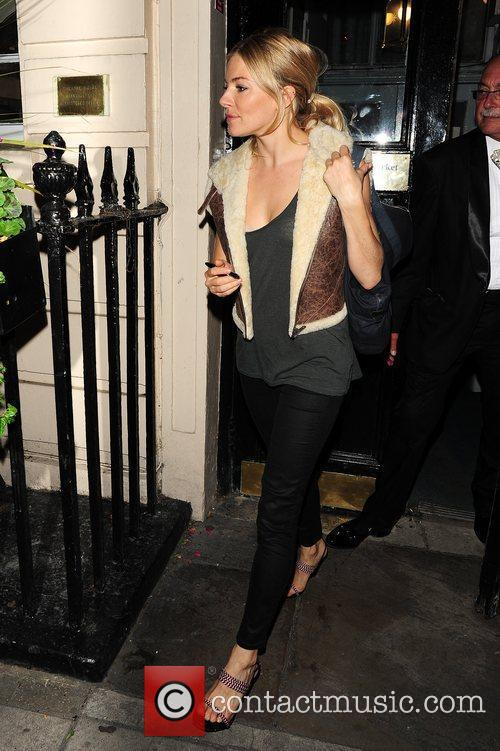 Leaving the Theatre Royal Haymarket after she performed...
