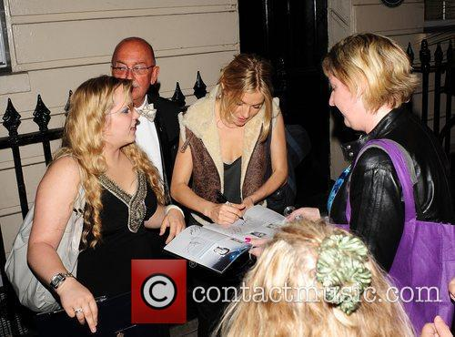 Sienna Miller signing autographs Sienna Miller leaving the...