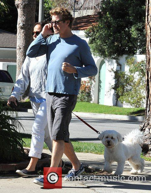 Simon Baker talking on his cellphone with his...