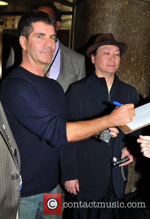 Simon Cowell signing an autograph outside NBC studios...