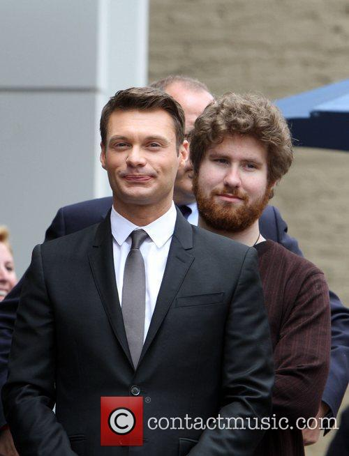 Ryan Seacrest and Casey Abrams 8