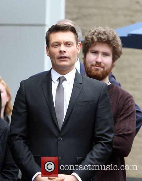 Ryan Seacrest and Casey Abrams 7