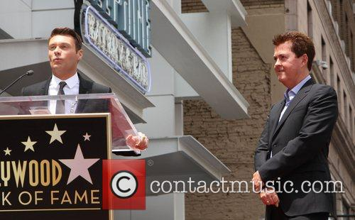 Ryan Seacrest and Simon Fuller 11
