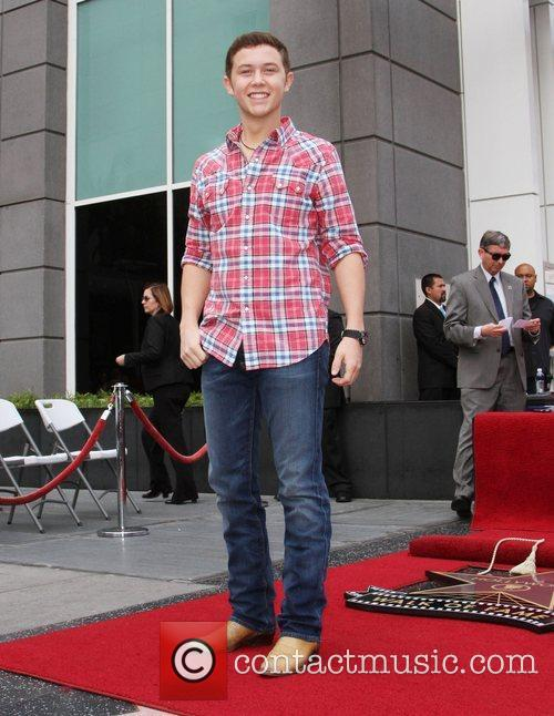Scotty McCreery Simon Fuller receives a star on...
