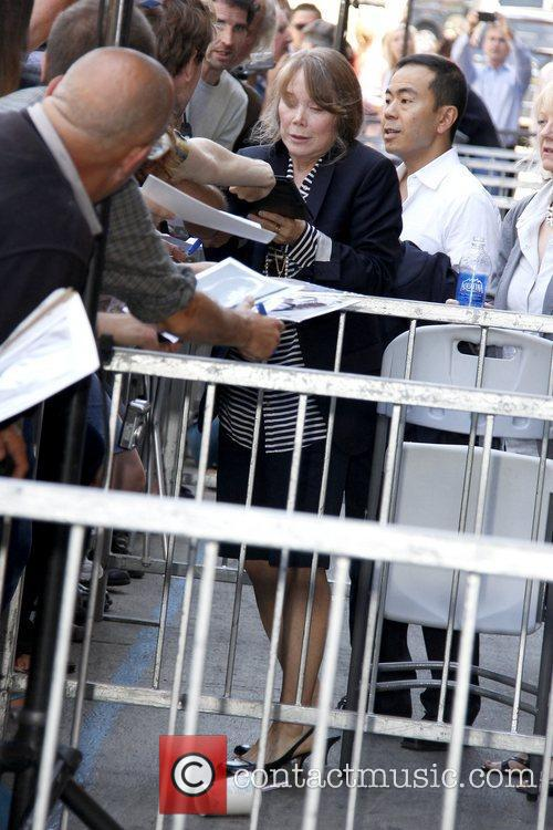 Sissy Spacek signs autographs as she receives a...
