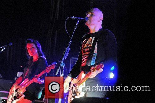 Billy Corgan of the Smashing Pumpkins performing at...