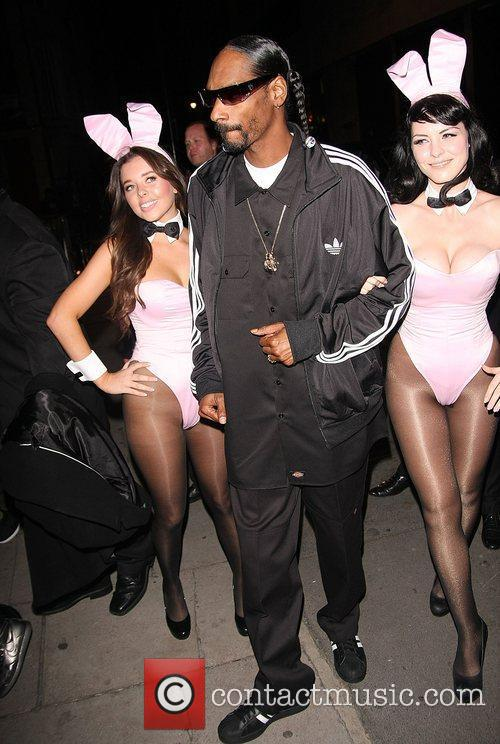 Snoop Dogg with pink bunny girls at the...