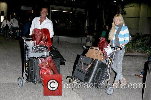 Sophie Monk arriving at LAX airport with her...