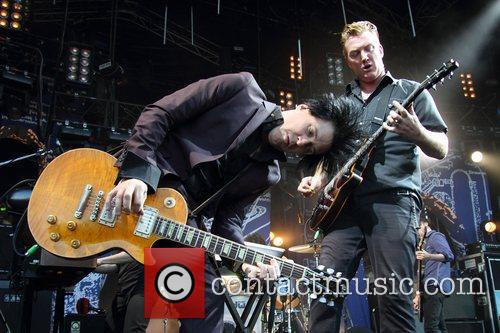 Queens of the Stone Age performing