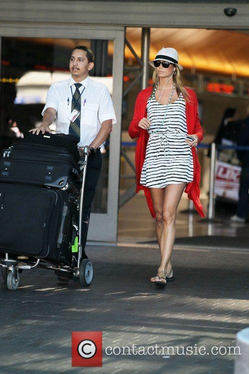 Former professional wrestler, Stacy Keibler, arrives at LAX...