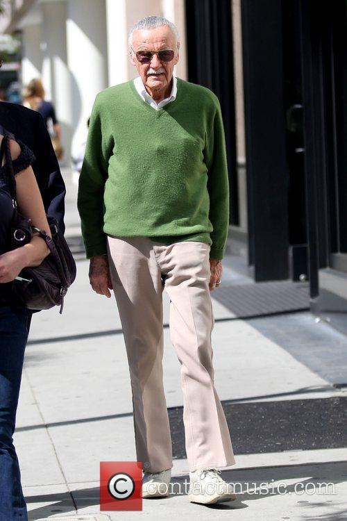 Wearing a green sweater as he errands in...