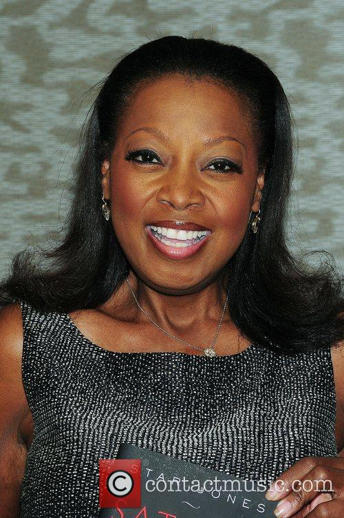 Star Jones signs copies of her new book...