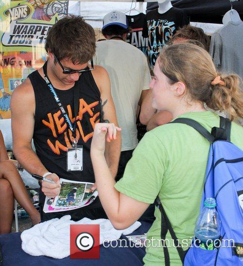 Stephen Jerzak signs autographs during the 2011 Vans...