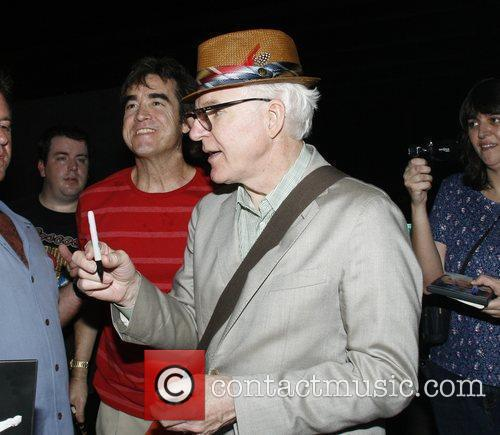 Steve Martin signs autographs after his bluegrass music...