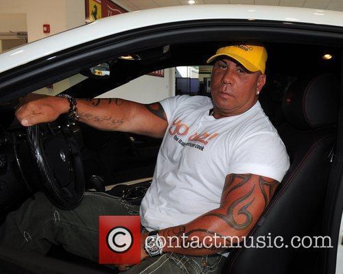 Receives a delivery of his new Maserati Granturismo...